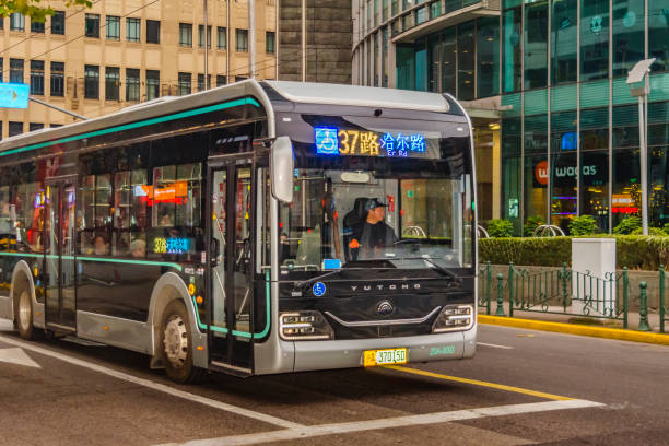 Public Bus, Pudong, Shanghai SHANGHAI, CHINA, DECEMBER - 2018 - Modern public bus waiting to advance at pudong district, shanghai, china pudong stock pictures, royalty-free photos & images