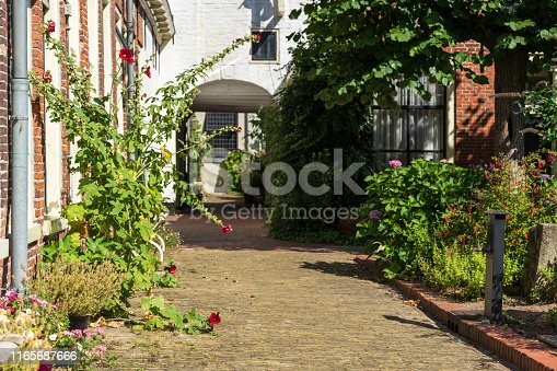 Detail of old public courtyard 'Pepergasthuis' in the Dutch city of Groningen on a summers day.