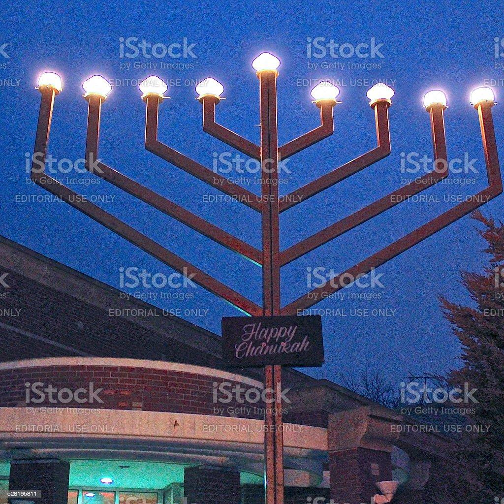 Public display electric outdoor Hanukkah menorah evening view stock photo