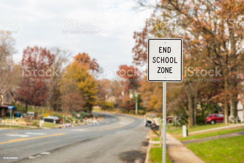 Public End School Zone sign on road stock photo