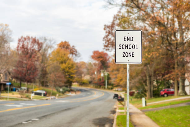 Public End School Zone sign on road Public End School Zone sign on road time zone stock pictures, royalty-free photos & images