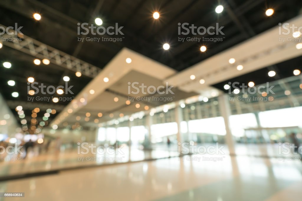 Public event exhibition hall, blurred bokeh defocused background, business trade show or modern interior architecture concept stock photo