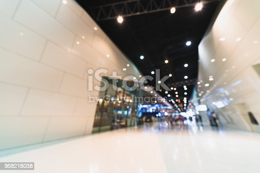 857615704 istock photo Public event exhibition hall, blurred bokeh defocused background, business trade show or modern interior architecture concept 958218038