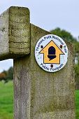 Public footpath sign for the Thames Path National Trail, England