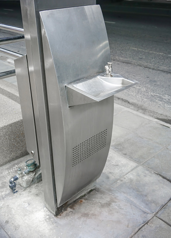 istock Public free drinking fountain tap made of stainless stell in modern design on walkway 983095862
