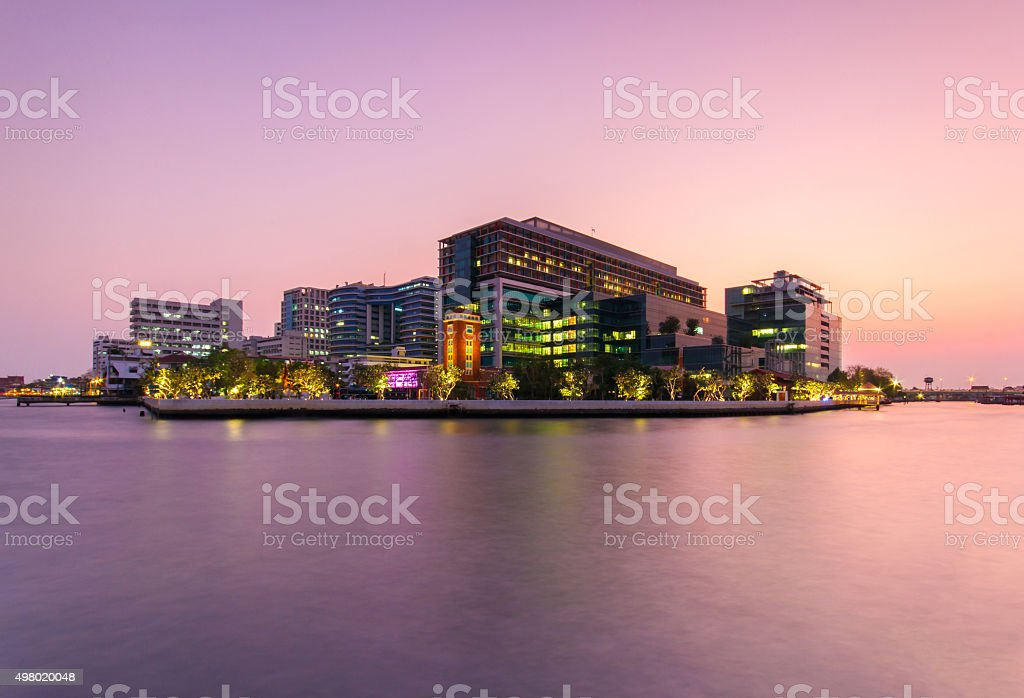 Public Hospital at twilight time in the river stock photo