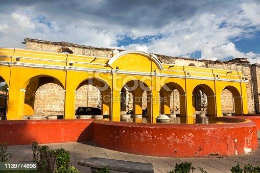 Public Laundry Fountain, Tanque lavadero el Parque la Union, with Spanish Colonial Architecture Yellow Arches in Old City Antigua Guatemala, Unesco World Heritage Site