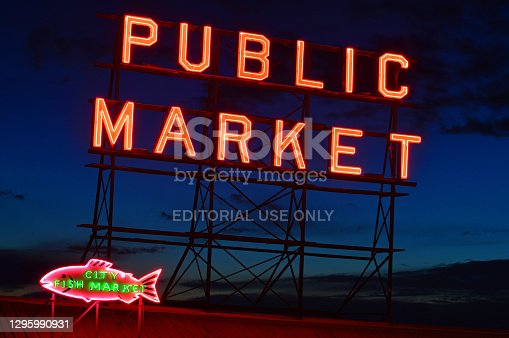 Seattle, WA, USA October 23 The neon sign of the Public Market brightens a dusk sky over Seattle
