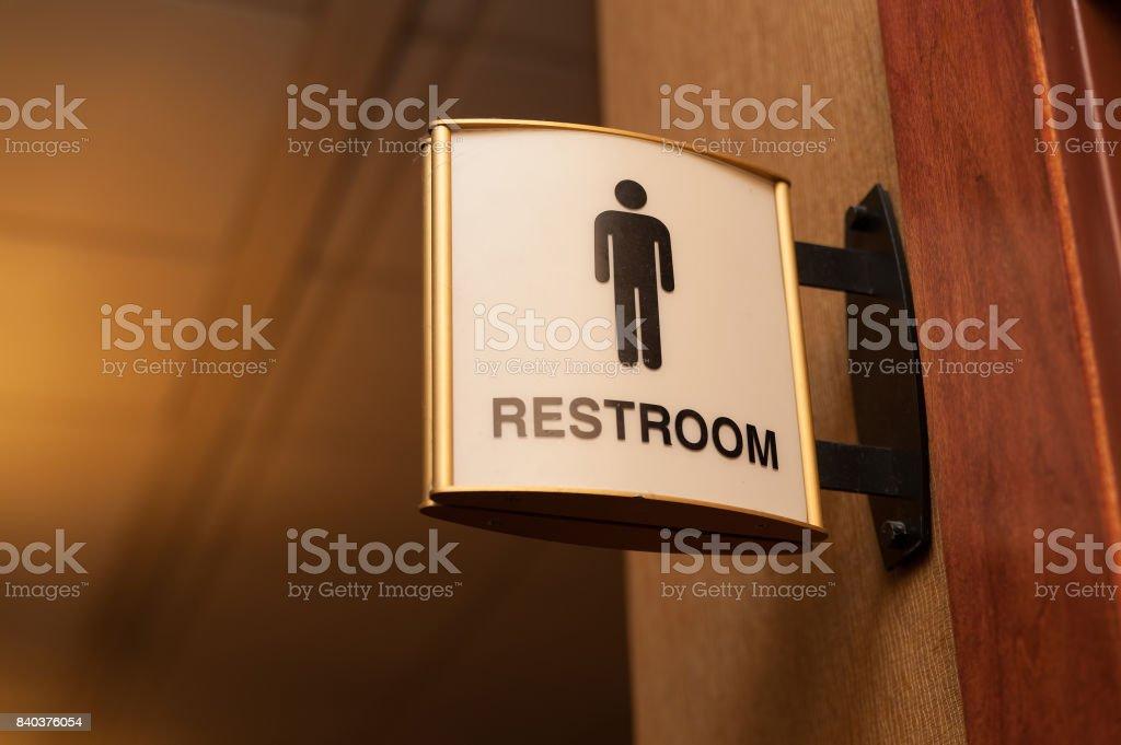 Public men restroom sign close up image stock photo