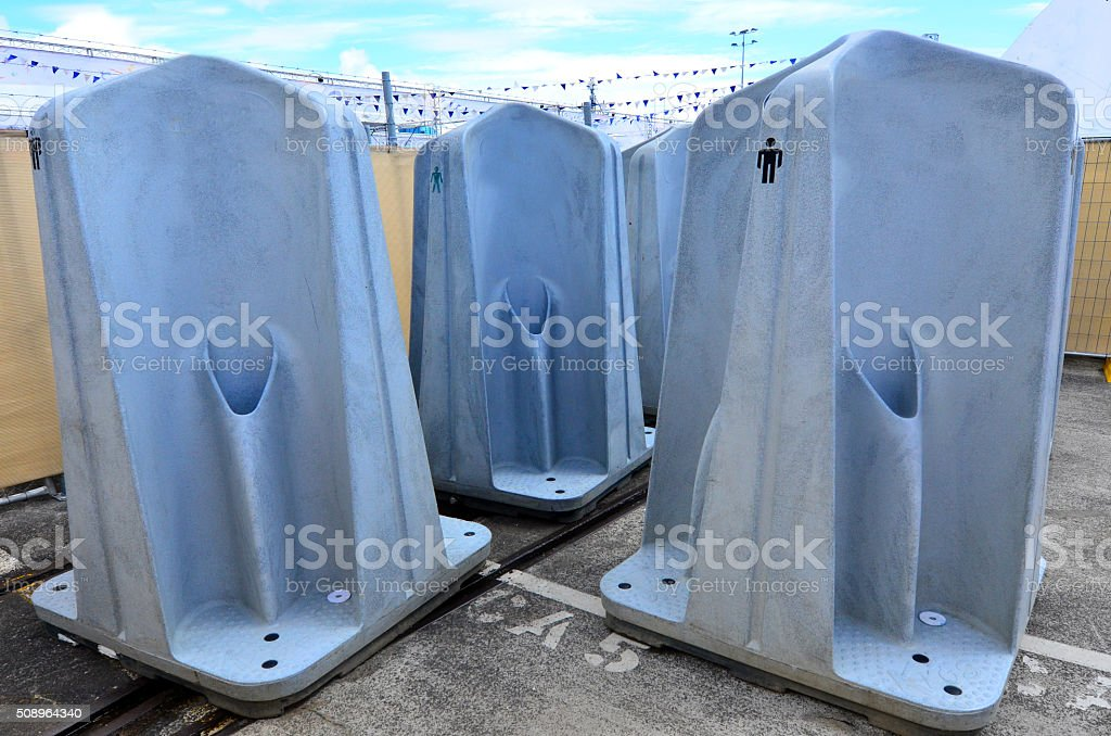 Public outdoors men urinal units stock photo