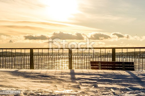 Sunset over Levis Terrace, south shore of Quebec city, with Saint Lawrence river in background during a cold winter day.