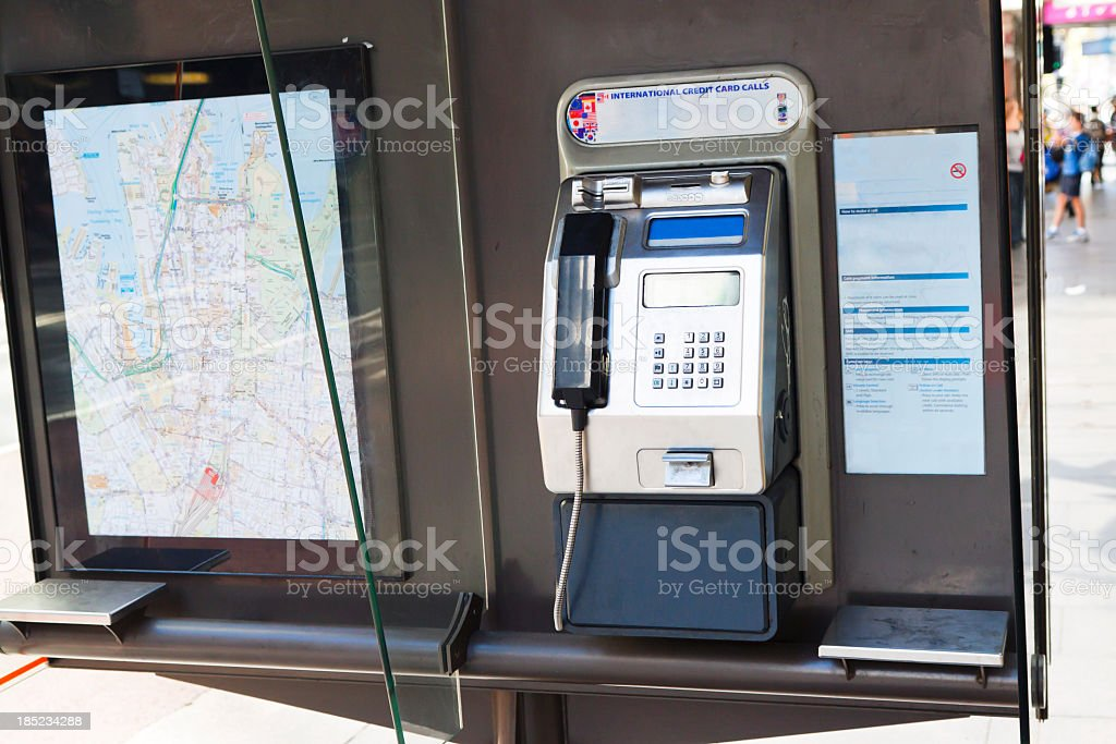 Public pay phone with map of Sydney royalty-free stock photo