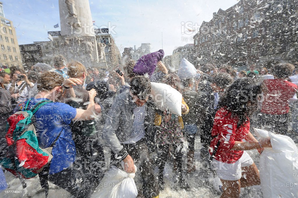 Public pillow fight on Dam Square Amsterdam royalty-free stock photo