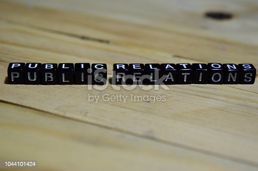 1140385944 istock photo Public relations message written on wooden blocks. 1044101424