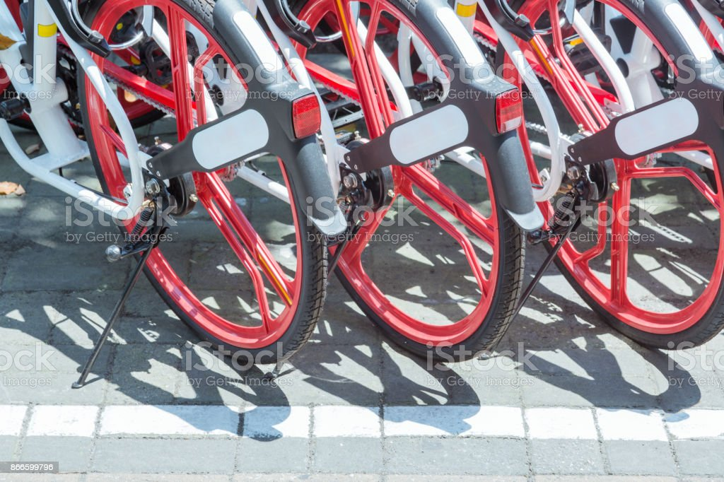 Public rental bicycles in a line stock photo