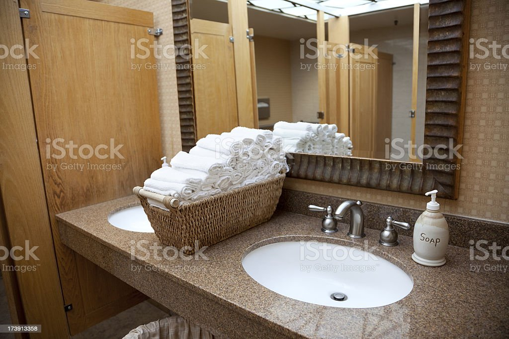 Public Restroom Sink in Hotel; Mirror, Cloth Towels, Marble Counter royalty-free stock photo