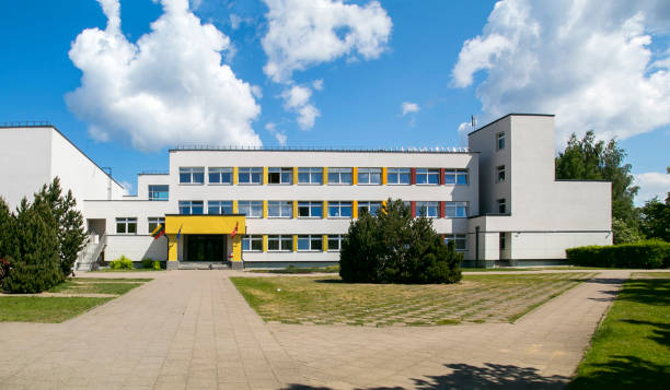 Public school building. Exterior view of school building with playground Public school building. Exterior view of school building with playground. Sunny sky with clouds school exteriors stock pictures, royalty-free photos & images