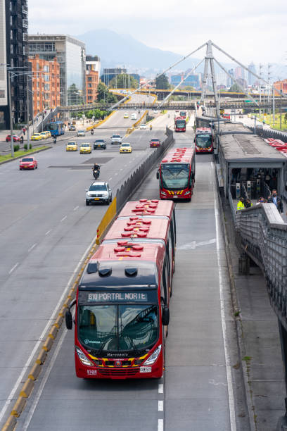 Public service buses in operation at a station in Bogota. Colombia. Public transport buses during the coronavirus quarantine season. Bogotá. Colombia . April 28, 2020. bus rapid transit stock pictures, royalty-free photos & images