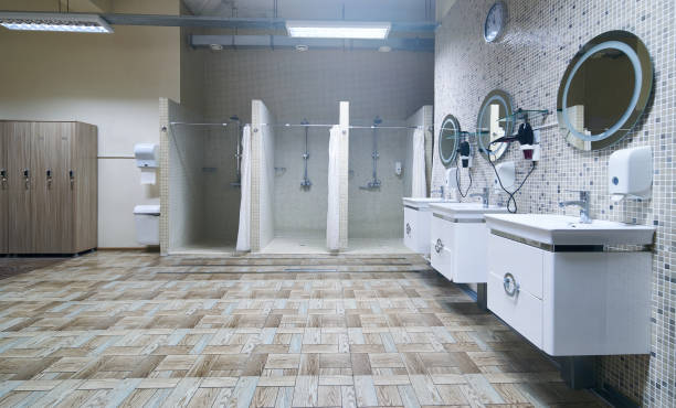 Public shower interior with everal showers stock photo