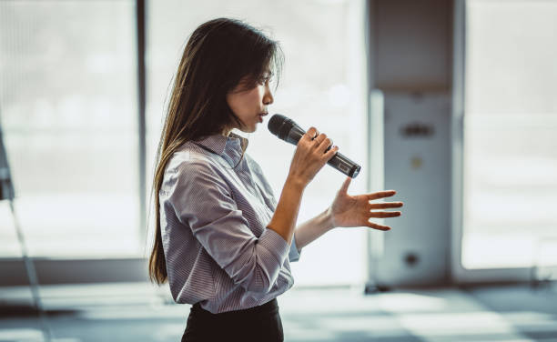 Public Speaker at a Conference Public Speaker at a Conference speech stock pictures, royalty-free photos & images
