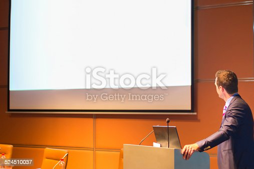 595328682 istock photo Public speaker at Business Conference. 524510037