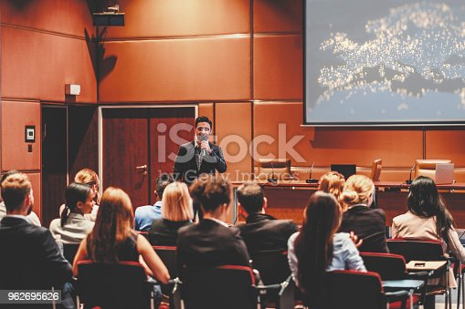 istock Public speaker at marketing seminar 962695626