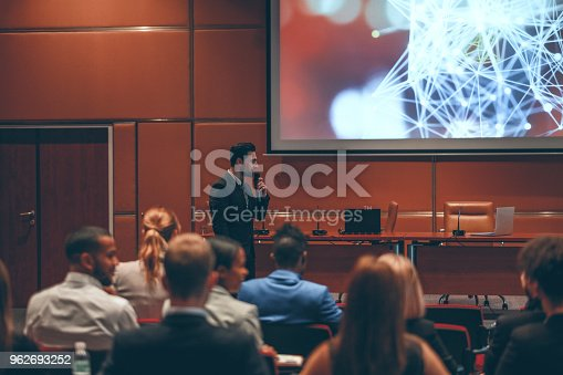 istock Public speaker at science convention 962693252