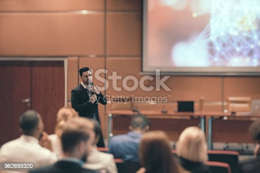 istock Public speaker at science convention 962693320