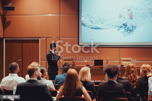 istock Public speaker at science convention 962693380