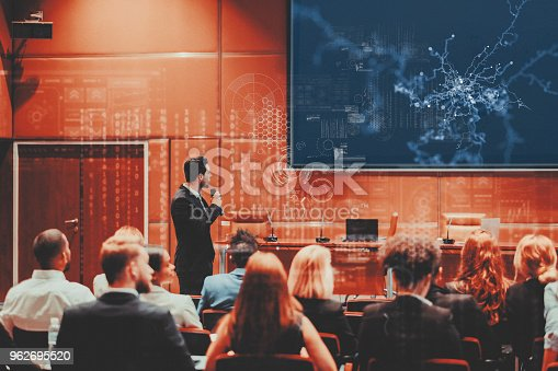 istock Public speaker at science convention 962695520