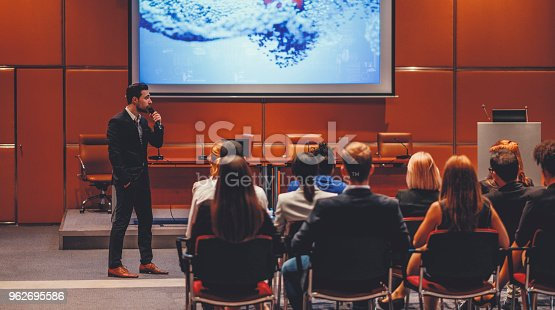 istock Public speaker at science convention 962695586