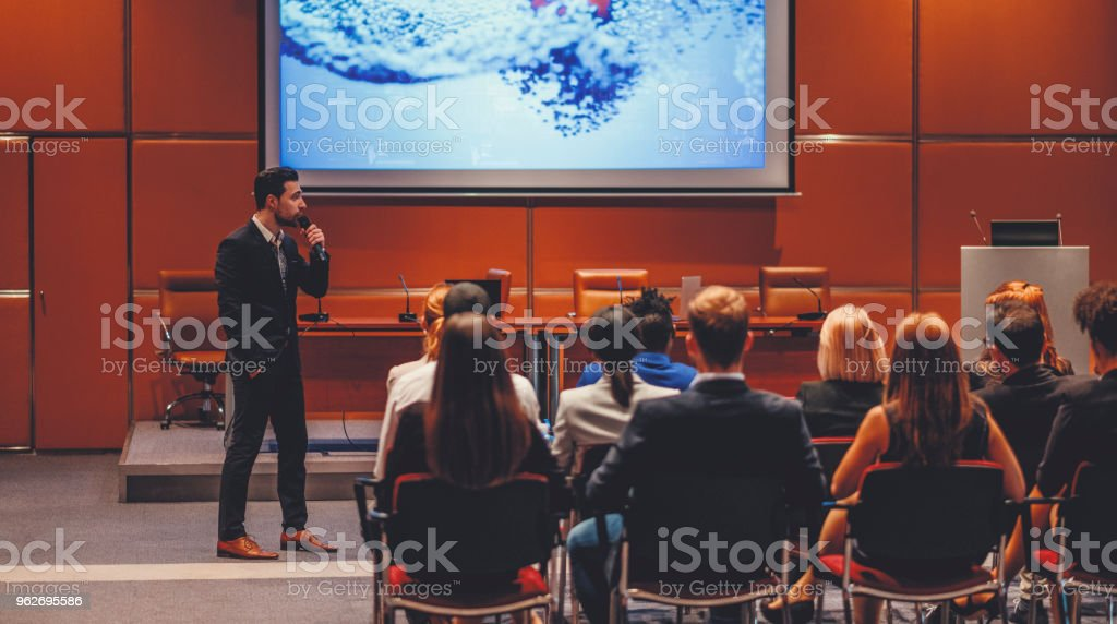 Public speaker at science convention stock photo