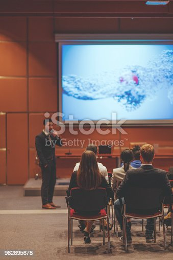 istock Public speaker at science convention 962695678