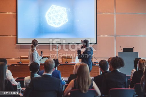 istock Public speaker at science convention 962696024
