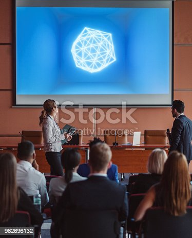 istock Public speaker at science convention 962696132