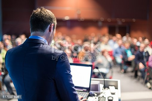 1069233370 istock photo Public speaker giving talk at business event. 1170078981