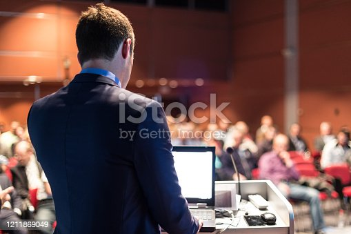 1069233370 istock photo Public speaker giving talk at business event. 1211869049