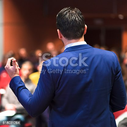 595328682 istock photo Public speaker giving talk at Business Event. 518031264
