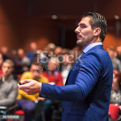 595328682 istock photo Public speaker giving talk at Business Event. 587550806