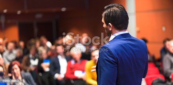595328682 istock photo Public speaker giving talk at Business Event. 595328652
