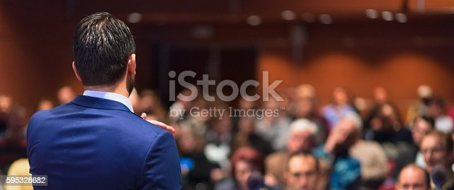 istock Public speaker giving talk at Business Event. 595328682