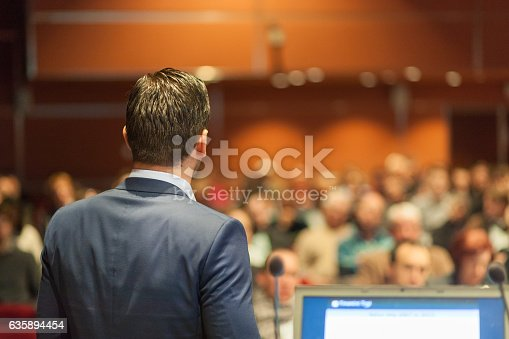 595328682 istock photo Public speaker giving talk at Business Event. 635894454