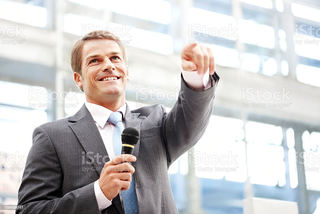Public Speaker Pointing to the Crowd royalty-free stock photo