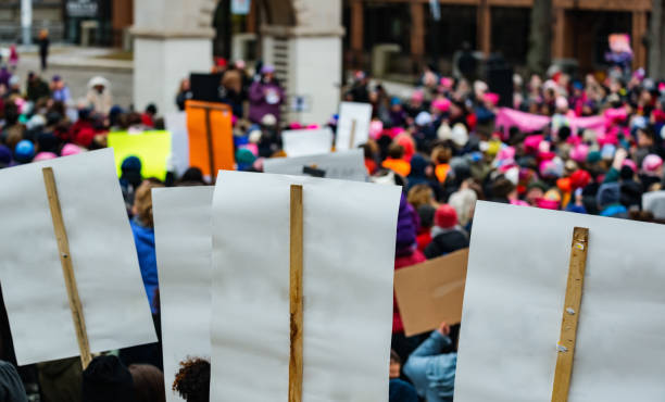 Public Square Protest Large crowd of protesters in a public square. activist stock pictures, royalty-free photos & images