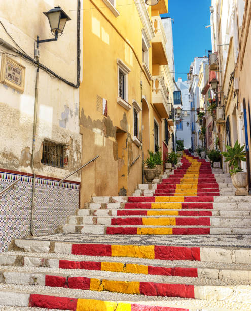 Public steps painted with Spanish flag colors in Southern Spain village stock photo