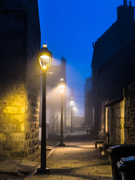 public street lights in fog, footdee, aberdeen - sherlock holmes stock photos and pictures