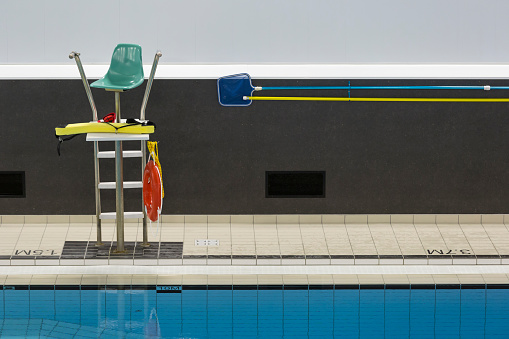 Public swimming pool with lifeguard chair