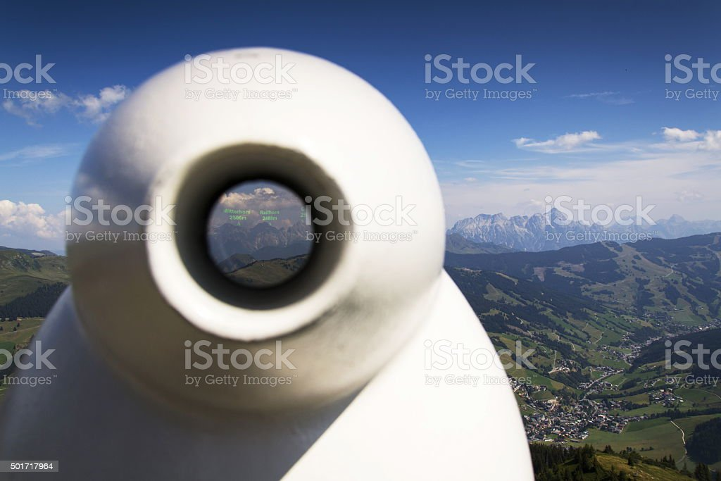 Public telescope arrayed against Loferer Mountains mountain range  Alps Austria stock photo