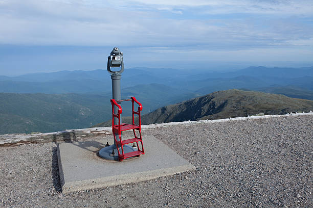 """Public Telescope """"Public telescope on top of a mountain with view of the White Mountains, New Hampshire. A view from Mt. Washington. Medium depth of field, telescope sharp but the landscape slightly soft."""" mount washington new hampshire stock pictures, royalty-free photos & images"""