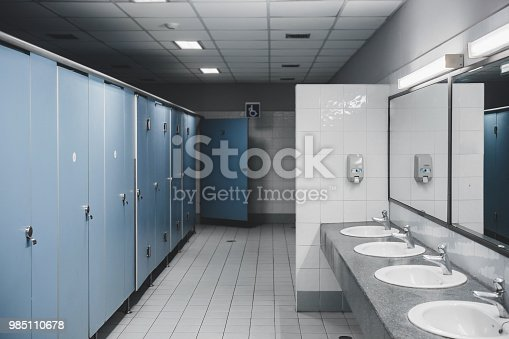 Public toilet and Bathroom interior with white urinals, Close-up of the wash bowl and chamber pot or urinal men with the stain dirty in the toilet.